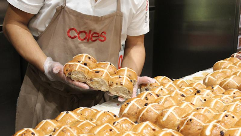 Coles hot cross buns fresh out of the bakery can be seen.