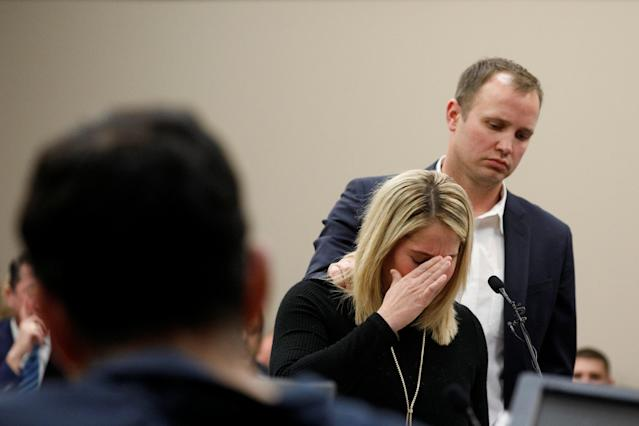 Victim Chelsea Williams, a former gymnast, is comforted by her husband as she speaks during a sentencing hearing for Larry Nassar. (Reuters)