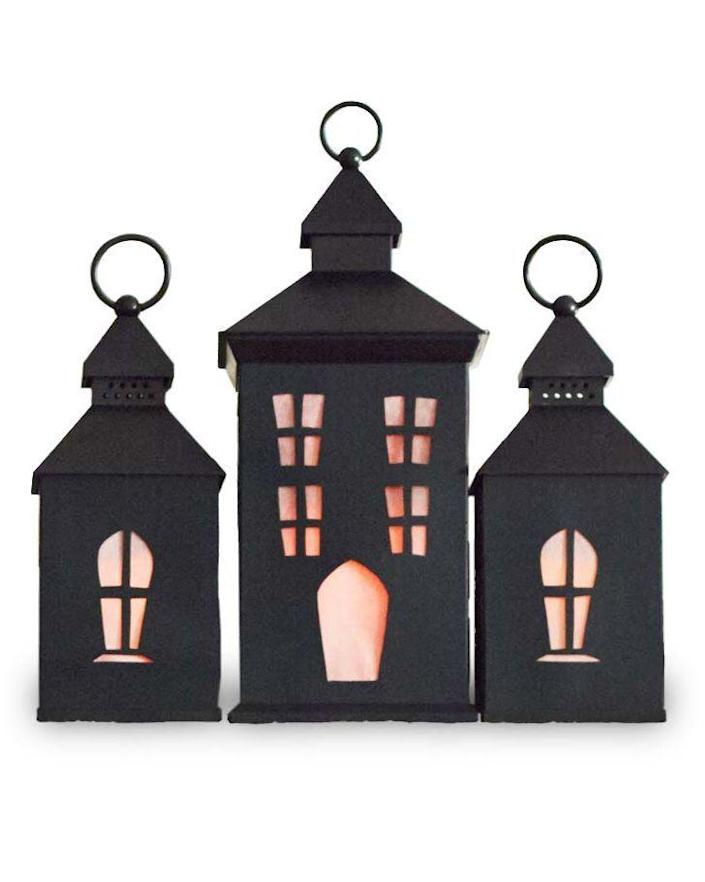 """<p>Build an eerie Halloween village with black metal lanterns, then add LED lights for a candlelit glow.</p><p><strong><em><a href=""""https://www.womansday.com/home/crafts-projects/g22840971/halloween-2018-templates/"""" rel=""""nofollow noopener"""" target=""""_blank"""" data-ylk=""""slk:Get the Spooky Houses template"""" class=""""link rapid-noclick-resp"""">Get the Spooky Houses template</a>. </em></strong></p><p><a class=""""link rapid-noclick-resp"""" href=""""https://www.amazon.com/Hanging-Lantern-Portable-Operated-Decoration/dp/B01I4H53N4/?tag=syn-yahoo-20&ascsubtag=%5Bartid%7C10070.g.2488%5Bsrc%7Cyahoo-us"""" rel=""""nofollow noopener"""" target=""""_blank"""" data-ylk=""""slk:SHOP METAL LANTERNS"""">SHOP METAL LANTERNS</a></p>"""