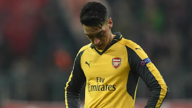Mesut Ozil is desperate to win the Champions League, which is why he was hit so hard by Arsenal's last-16 exit, says Arsene Wenger.