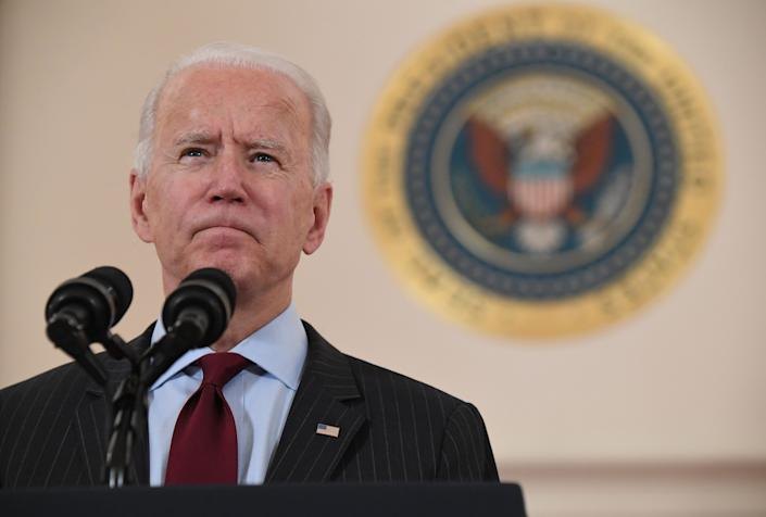 President Joe Biden speaks about lives lost to Covid after death toll passed 500,000, in the Cross Hall of the White House in Washington, DC, February 22, 2021. (Saul Loeb/AFP via Getty Images)