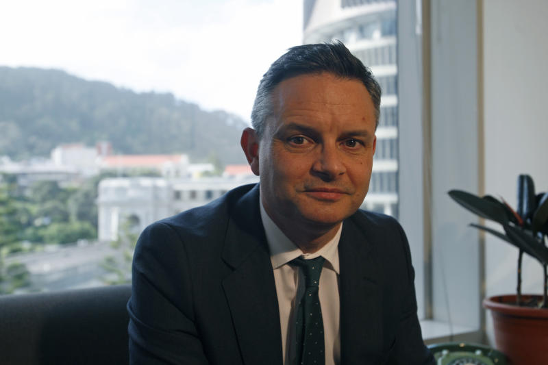 In this Dec. 4, 2018, photo, New Zealand's Climate Change Minister James Shaw poses in Wellington, New Zealand. New Zealand has set itself apart from neighboring Australia by declaring climate change a top priority. But despite some lofty goals, greenhouse gas emissions continue to rise in the South Pacific nation and could do so for years to come. (AP Photo/Nick Perry)