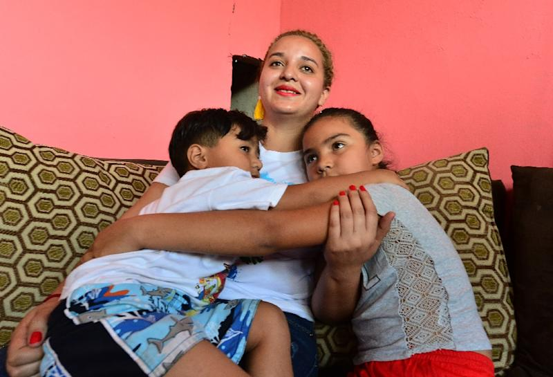 Ruth Elizabeth Gomez left her children Dorian (left), 5, and Alejandra, 8, behind in Honduras when she attempted to emigrate to the United States, only to be deported home (AFP Photo/ORLANDO SIERRA)