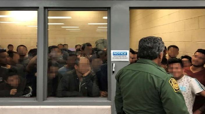 Men are crowded in a room at a Border Patrol station in a still image from video in McAllen, Texas, U.S. on June 10, 2019 and released as part of a report by the Department of Homeland Security's Office of Inspector General on July 2, 2019. Picture pixelated at source. (Photo: Office of Inspector General/DHS/Handout via Reuters)