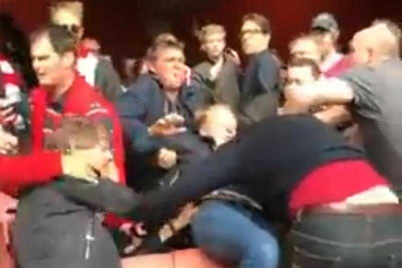 Brawl: Arsenal fans fight each other during clash with Manchester City: Twitter/@15suhayb