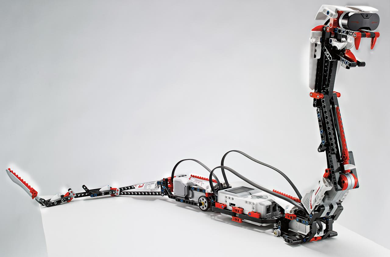 """This undated photo provided by Lego shows """"Reptar,"""" a robotic snake that is one of 17 possible creations available in the new, $350 Lego Mindstorms EV3 platform that will have the ability to talk to iPhones, iPads and iPod Touches through Bluetooth wireless connections. Lego is scheduled to announce the kit at the International Consumer Electronics Show, Monday, Jan. 7, 2013, in Las Vegas. (AP Photo/LEGO)"""