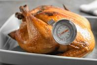 """<p>Though there are rough estimates for how long it takes a turkey to roast, the only guaranteed way you will know your dinner is done is when it reaches a minimum internal temperature of 165 degrees. Use a meat thermometer and take the temperature in the thickest part of the breast, thigh and stuffing (if you stuffed your bird). No matter what you do, <a href=""""https://www.thedailymeal.com/cook/are-turkey-pop-up-timers-accurate?referrer=yahoo&category=beauty_food&include_utm=1&utm_medium=referral&utm_source=yahoo&utm_campaign=feed"""" rel=""""nofollow noopener"""" target=""""_blank"""" data-ylk=""""slk:don't rely simply on those plastic pop-up timers"""" class=""""link rapid-noclick-resp"""">don't rely simply on those plastic pop-up timers</a> many turkeys come equipped with, or by the color of the skin. By the time they pop up, your turkey may be completely overcooked and dry. Additionally, your turkey's skin may look golden brown long before it has reached a safe temperature.</p>"""