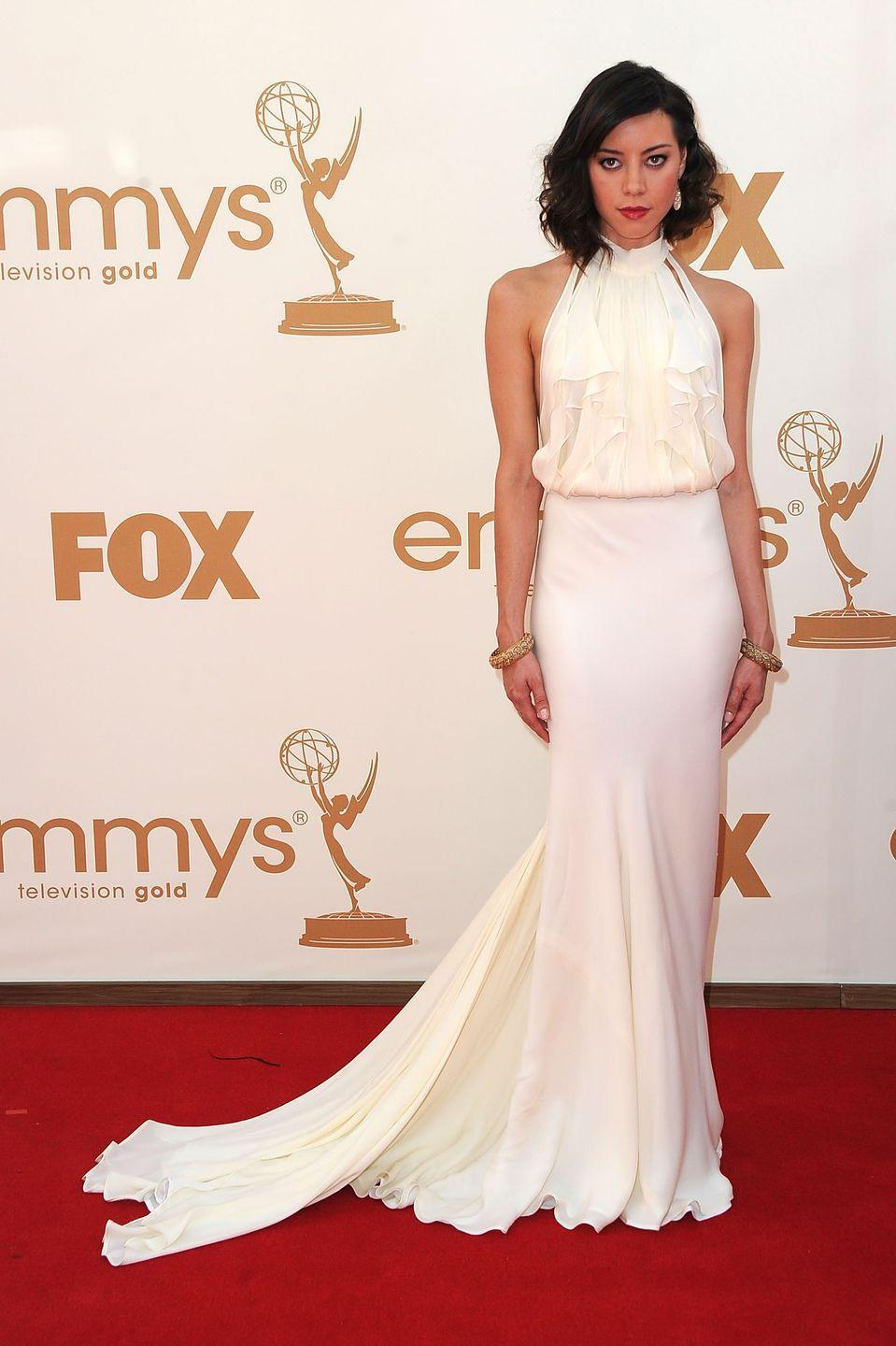 <p>Plaza walked the Emmy red carpet in a beautiful white gown in 2011. </p>