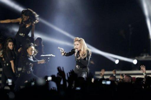 Madonna performs on stage at the Stade de France in the Paris suburb of Saint-Denis on July 14