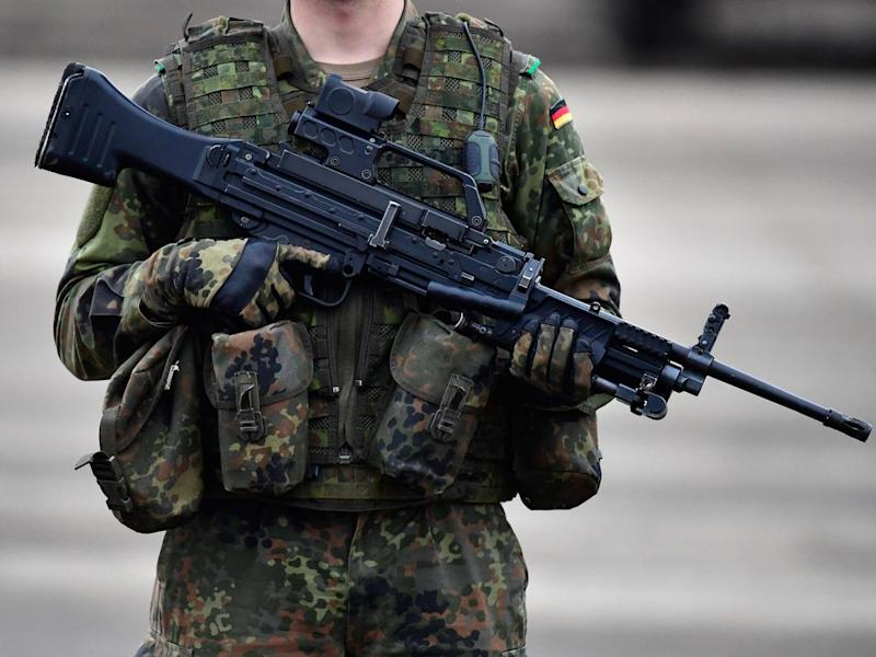 A German soldier holds a machine gun MG4 during the 'Land Operations' military exercises during a media day at the Bundeswehr training grounds on October 14, 2016 near Bergen, Germany. The exercises are taking place from October 4-14. (Getty Images)