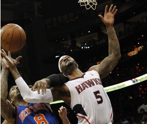 Atlanta Hawks forward Josh Smith (5) and New York Knicks guard J.R. Smith (8) battle for a rebound during the second half of an NBA basketball game in Atlanta, Friday, March 30, 2012. Atlanta won 100-90. (AP Photo/John Bazemore)