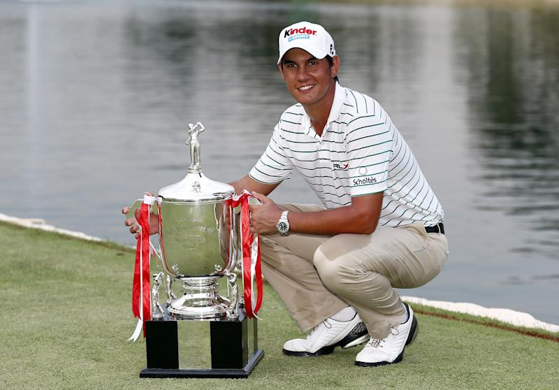 SINGAPORE - NOVEMBER 11: Matteo Manassero of Italy poses for photographs with the Barclay's Singapore Open Champion Trophy after he won it in a play off during the fourth round of the Barclays Singapore Open at  the Sentosa Golf Club on November 11, 2012 in Singapore. Singapore.  (Photo by Stanley Chou/Getty Images)