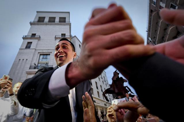 Five-Stars Movement (M5S) leader Luigi Di Maio salutes the crowd during a rally in Naples, Italy, Tuesday, May 29, 2018. (Ciro Fusco/ANSA via AP)