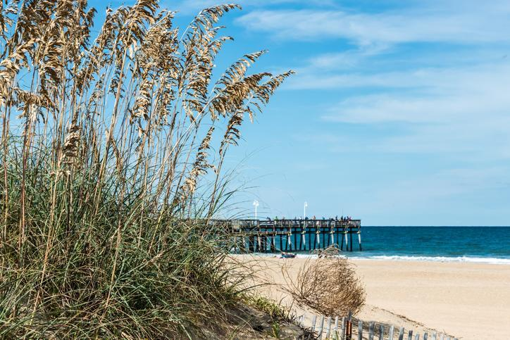 "<p>Officially a part of the Virginia Beach metro area, this <a href=""https://www.virginia.org/listings/OutdoorsAndSports/SandbridgeBeach/"" rel=""nofollow noopener"" target=""_blank"" data-ylk=""slk:secluded hideaway"" class=""link rapid-noclick-resp"">secluded hideaway</a> of five miles of pristine dunes and wild oats 15 miles south of the boardwalk-and-funnel-cake action is an incredible discovery with a family vibe. The peaceful community of beach houses and small restaurants just adds to the magic.</p>"