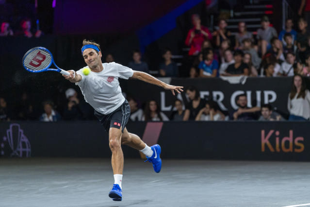Team Europe's Roger Federer returns a ball during a training session for the Laver Cup in Geneva, Switzerland, Thursday, Sept. 19, 2019. The competition will pit a team of the best six European players against the top six from the rest of the world. The Laver Cup edition is scheduled for Sept. 20-22, 2019 at the Palexpo in Geneva. The Cup is named after the Australian tennis legend Rod Laver. (Martial Trezzini/Keystone via AP)