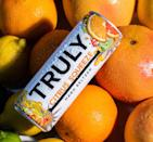 "<p>This new flavor will replace Truly's orange flavor and mixes together some of your favorite citrus flavors, like lime, grapefruit, and, yes, orange, together! Shop for it <a href=""https://www.instacart.com/products/3374071-truly-hard-seltzer-citrus-variety-pack-spiked-sparkling-water-12-fl-oz"" rel=""nofollow noopener"" target=""_blank"" data-ylk=""slk:here"" class=""link rapid-noclick-resp"">here</a>.</p>"