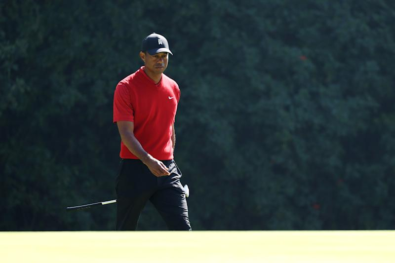 "Though he's only played three times this season, Tiger Woods is ""just not quite ready"" to return to the course while dealing with back stiffness. (Chris Trotman/Getty Images)"