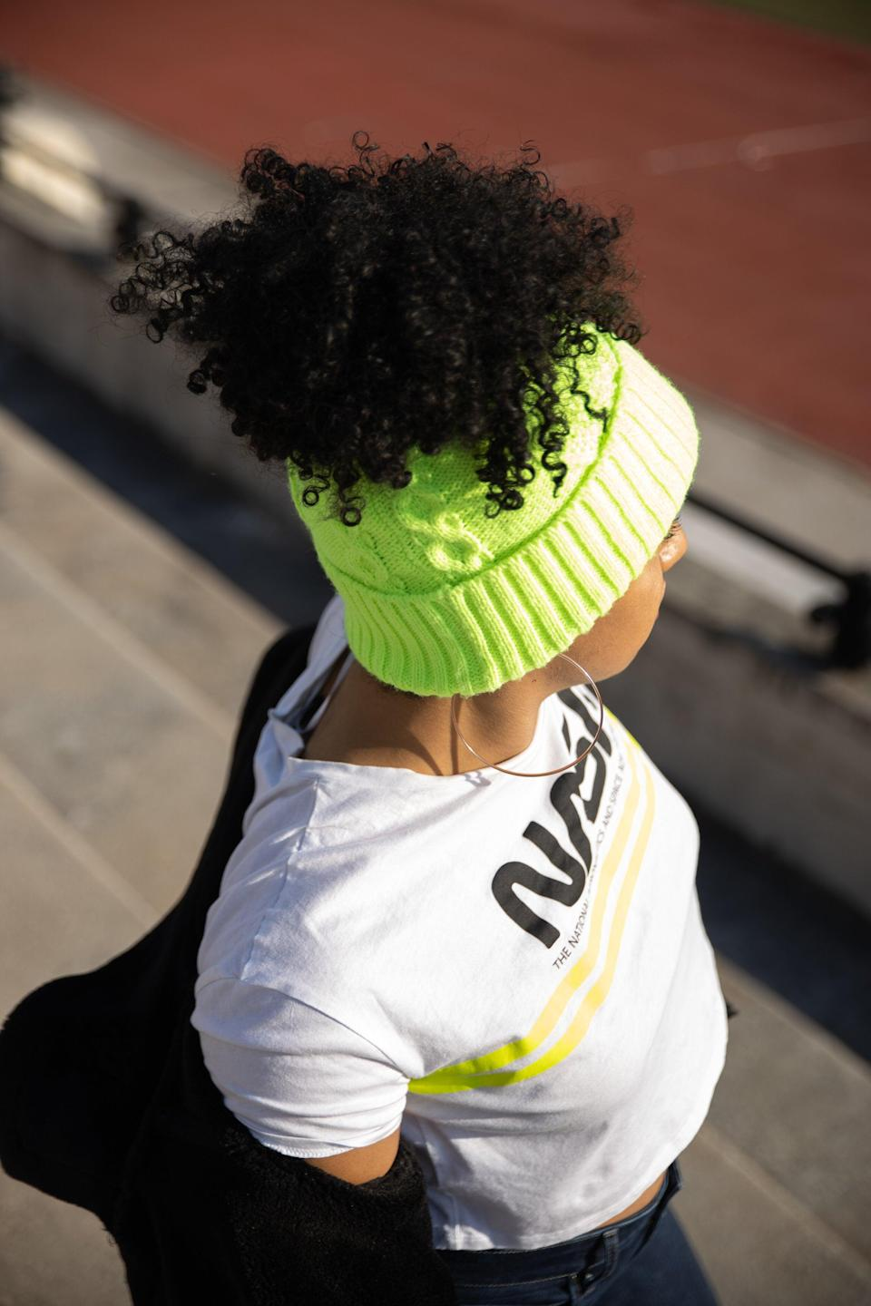 """<h2>Curl Code Bidi Bidi Pom Pom Ponytail Knitted Hat</h2><br>Most knitted beanies aren't designed to accommodate a puff or pineapple, but you shouldn't have to sacrifice your style for your warmth. This Curl Code piece allows you the best of both worlds: It's designed with an opening at the top of the hat for your ponytail to be left out. The inside is also satin-lined, so if you're trying to preserve a sleek bun or curly puff, this hat is your best bet.<br><br><strong>Curl Code</strong> Bidi Bidi Pom Pom Satin Lined Ponytail Knitted Hat, $, available at <a href=""""https://www.curlcode.co/collection/lime-green-knitted-hat"""" rel=""""nofollow noopener"""" target=""""_blank"""" data-ylk=""""slk:Curl Code"""" class=""""link rapid-noclick-resp"""">Curl Code</a>"""