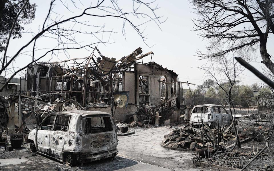 Burnt out cars and houses following a wildfire in Tatoi-Acharne, near Athens, Greece, on Wednesday, Aug. 4 - Nick Paleologos/Bloomberg