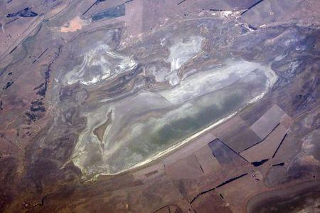 A lake with low levels of water can be seen in a drought affected farming land on the outskirts of Canberra in Australia
