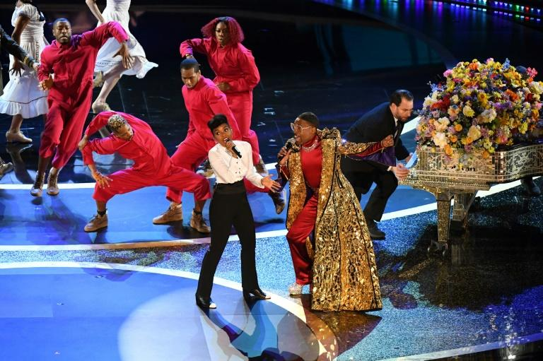 US singer-songwriter Janelle Monae (L) and US actor Billy Porter celebrated women and minorities on the Oscar stage, though the show's nominees are dominated by white men