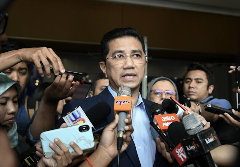 Economic Affairs Minister Datuk Seri Mohamed Azmin Ali speaks to the media after launching the Graduan Aspire Career Fair at the Kuala Lumpur Convention Centre July 13, 2019. — Bernama pic