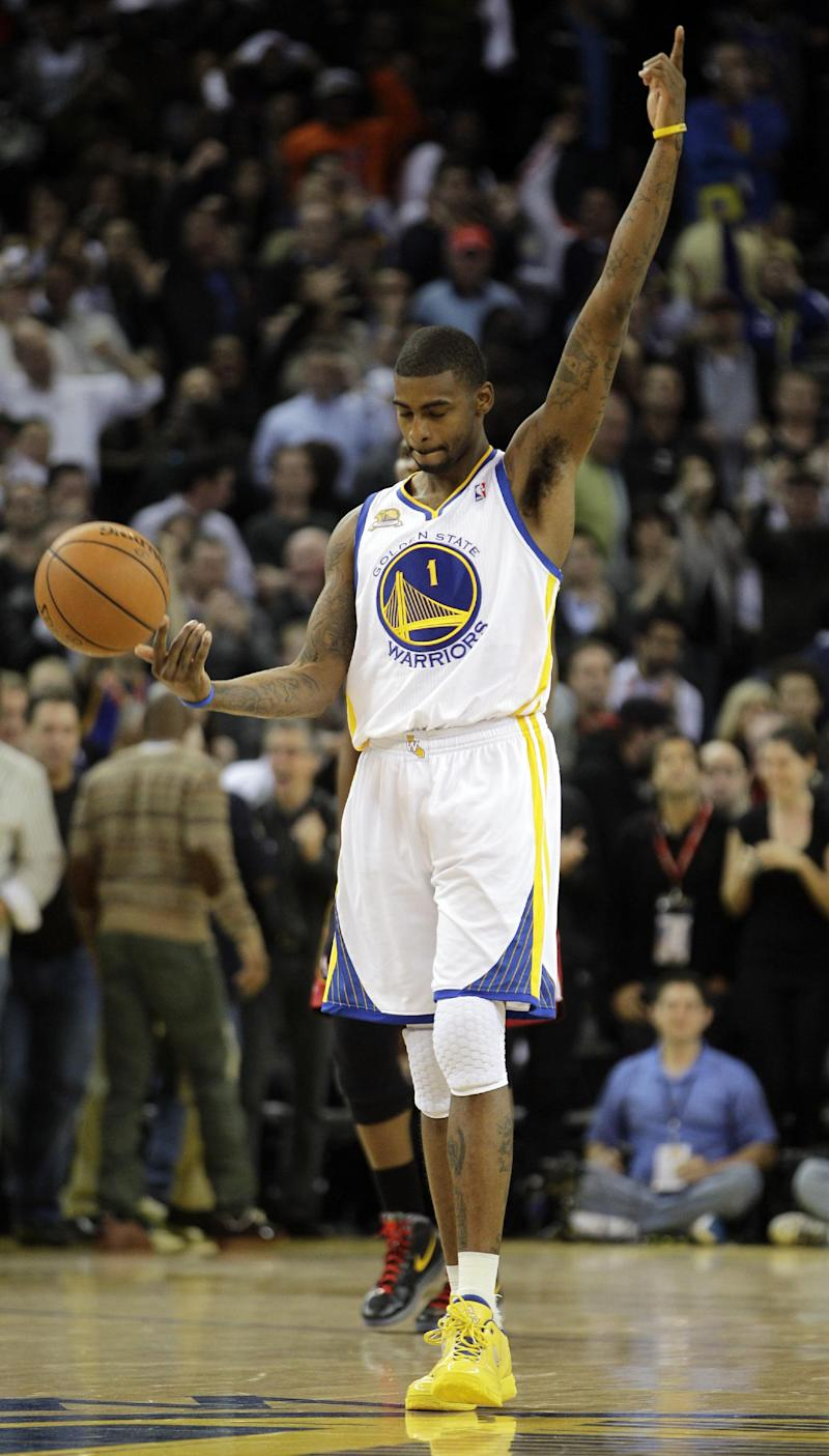 Golden State Warriors' Dorell Wright gestures during the final seconds of overtime during an NBA basketball game against the Miami Heat Tuesday, Jan. 10, 2012, in Oakland, Calif. Golden State Warriors won 111-106.  (AP Photo/Ben Margot)