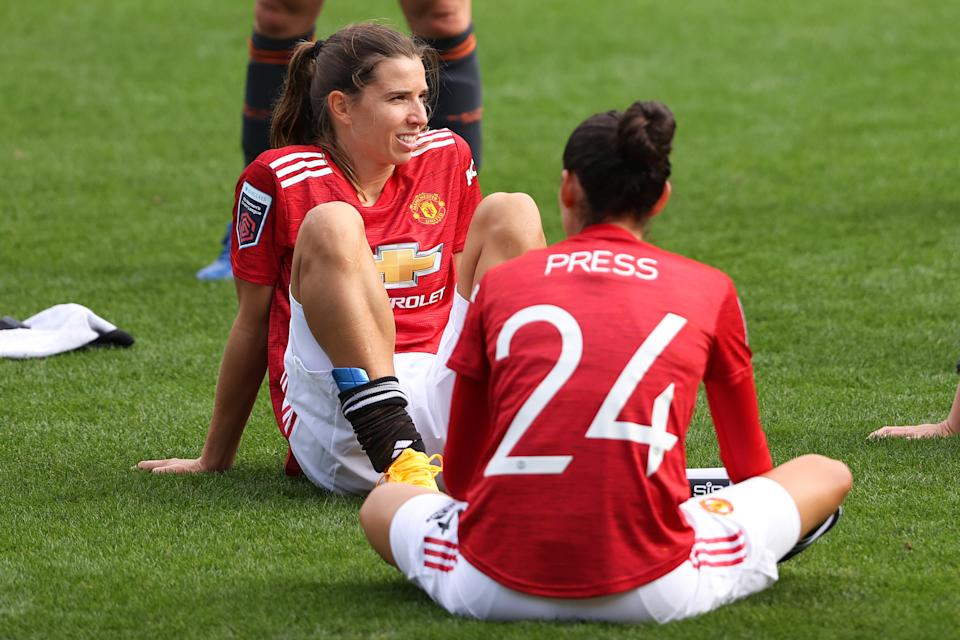 Tobin Heath and Christen Press had hot jersey sales after signing with Manchester United. (Matthew Ashton - AMA/Getty Images)