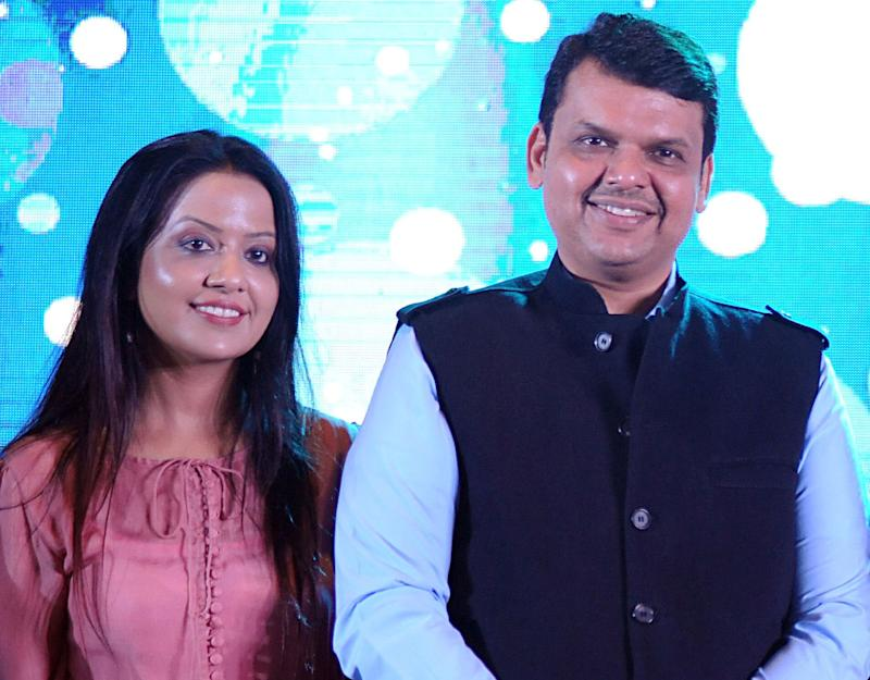 Maharashtra CM Devendra Fadnavis with his wife Amruta in a file photo (Photo: STR via Getty Images)
