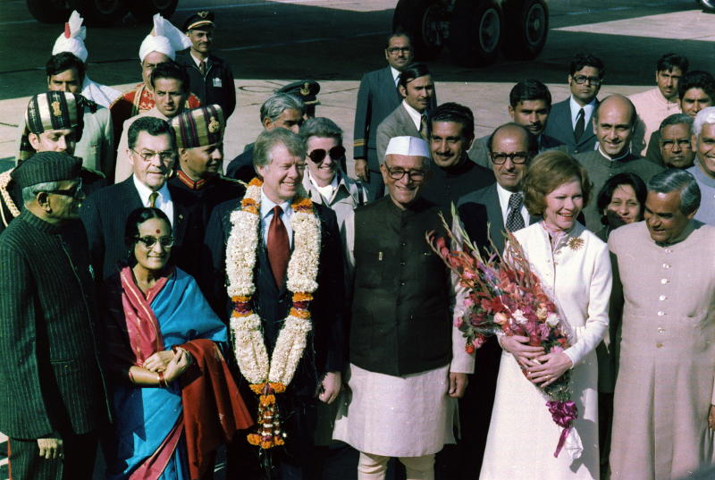 U.S. President Jimmy Carter is welcomed by Prime Minister Moraji Desai, standing with Rosalind Carter and future Indian Prime Minister Atal Bihari Vajpayee, during an arrival ceremony in New Delhi, India in January 1978. | Universal History Archive/Universal Images Group/Getty Images
