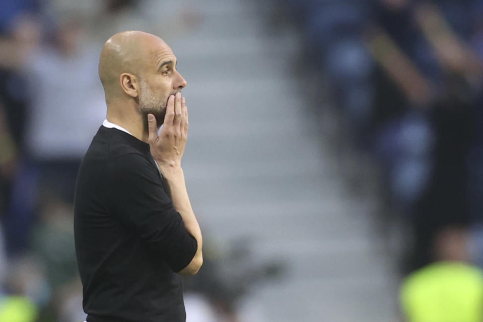 Manchester City's head coach Pep Guardiola gestures during the Champions League final soccer match between Manchester City and Chelsea at the Dragao Stadium in Porto, Portugal, Saturday, May 29, 2021. (Carl Recine/Pool via AP)