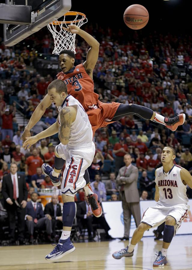 Utah's Princeton Onwas (3) blocks a shot by Arizona's Gabe York during the first half of an NCAA college basketball game in the quarterfinals of the Pac-12 Conference tournament, Thursday, March 13, 2014, in Las Vegas. (AP Photo/Julie Jacobson)