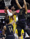 Minnesota center Daniel Oturu (25) pulls in a rebound between Northwestern guard Ryan Taylor, left, and center Barret Benson during the first half of an NCAA college basketball game Thursday, Feb. 28, 2019, in Evanston, Ill. (AP Photo/Nam Y. Huh)