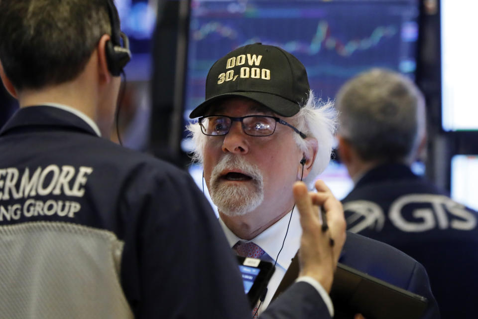 "Trader Peter Tuchman wears a ""Dow 30,000"" cap as he works on the floor of the New York Stock Exchange, Wednesday, March 4, 2020. (AP Photo/Richard Drew)"