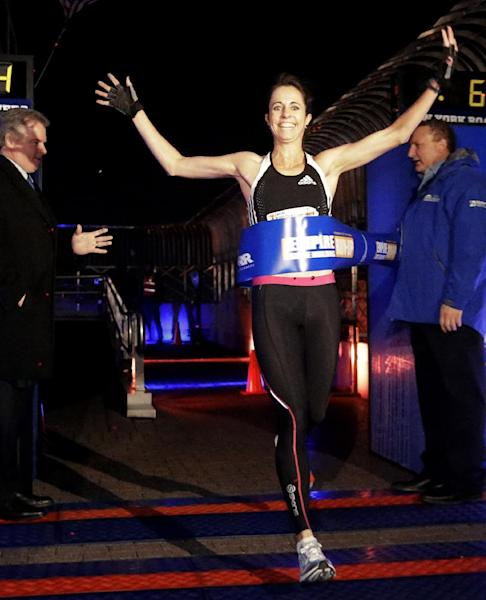 Suzy Walsham, of Australia, wins the women's invitational of the Empire State Building Run-Up, Wednesday, Feb. 6, 2013, in New York. (AP Photo/Frank Franklin II)