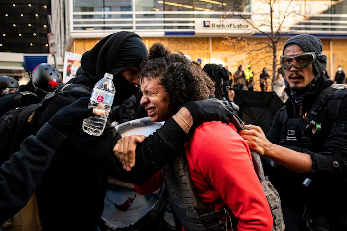 A chemical irritant was sprayed in the air as supporters of President Trump were met by counterprotesters near Black Lives Matter Plaza on Dec. 12, 2020, in Washington.