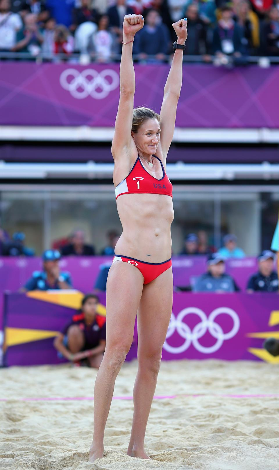 LONDON, ENGLAND - AUGUST 05: Kerri Walsh Jennings of the United States celebrates after winning match point during the Women's Beach Volleyball Quarter Final match between United States and Italy on Day 9 of the London 2012 Olympic Games at Horse Guards Parade on August 5, 2012 in London, England. (Photo by Ryan Pierse/Getty Images)