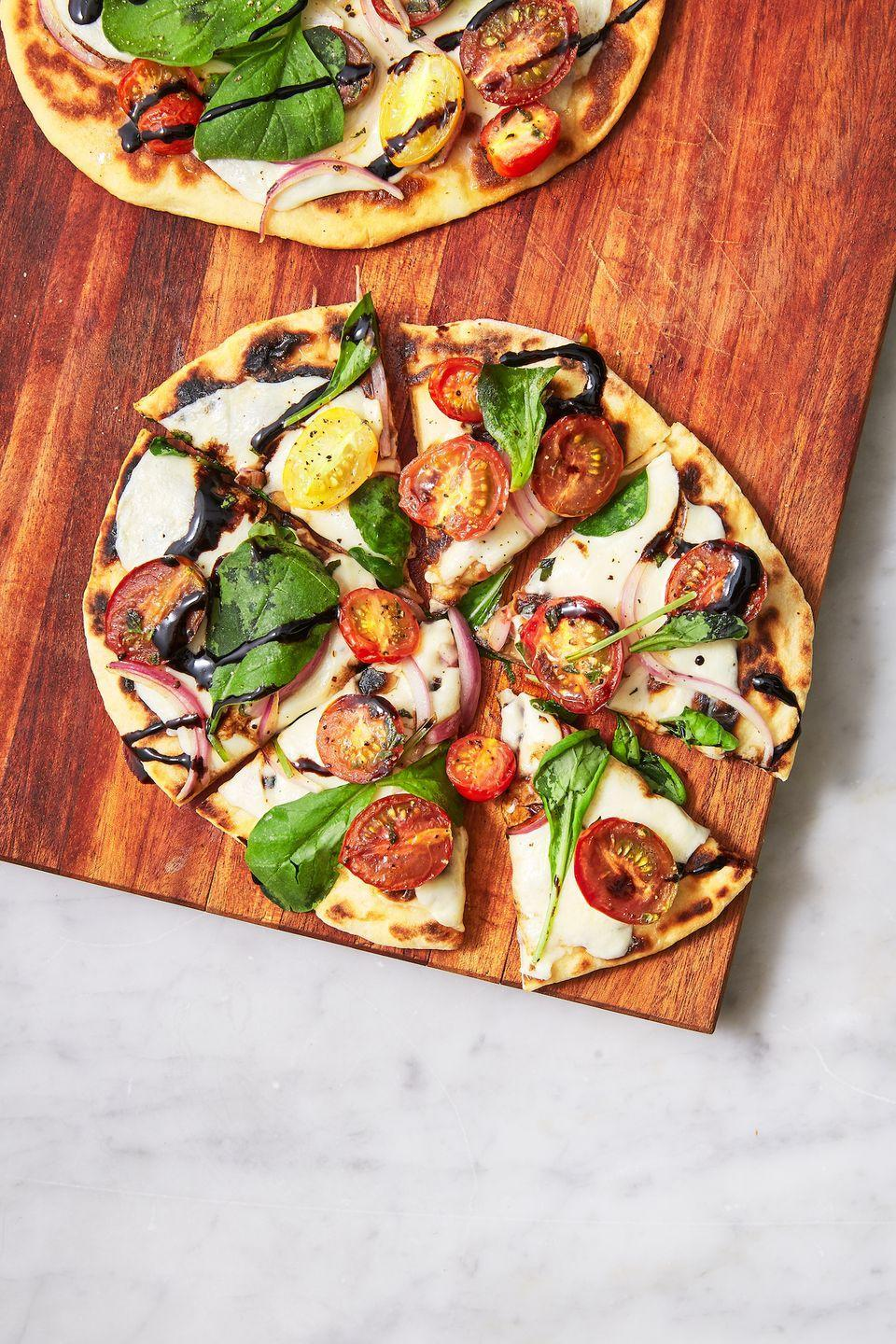 "<p>That balsamic glaze is rocking our world. </p><p>Get the recipe from <a href=""https://www.delish.com/cooking/recipe-ideas/a27794172/easy-flatbread-pizza-recipe/"" rel=""nofollow noopener"" target=""_blank"" data-ylk=""slk:Delish"" class=""link rapid-noclick-resp"">Delish</a>.</p>"