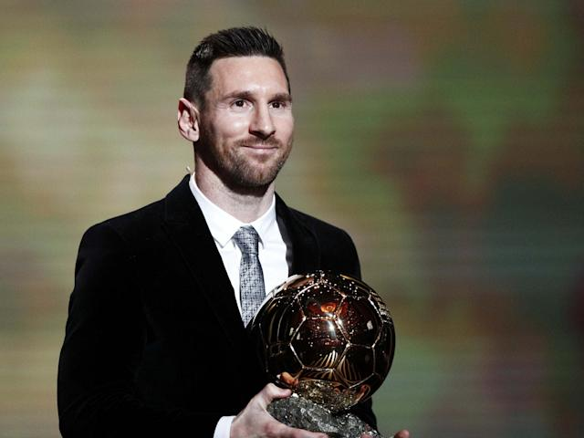 Lionel Messi collects his sixth Ballon d'Or at a ceremony in Paris: EPA