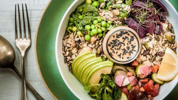 PHOTO: A vegan lunch bowl containing leafy greens, grains, seeds, vegetables, avocado and a peanut-miso sauce. (STOCK PHOTO/Getty Images)