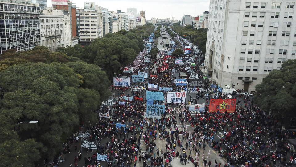 People march along the 9 de Julio Avenue to demand better wages and jobs, in Buenos Aires, Argentina, Friday, June 18, 2021. In the midst of a second wave of the new coronavirus, healthcare workers and social organizations marched due to high inflation and increasing poverty. (AP Photo/Victor R. Caivano)