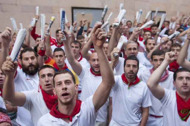 <p>Runners hold up newspapers while they sing to an image of San Fermin before the start of the running of the Jandilla's fighting bulls during the sixth day of the San Fermin Running of the Bulls festival on July 11, 2017 in Pamplona, Spain. (Gari Garaialde/Getty Images) </p>