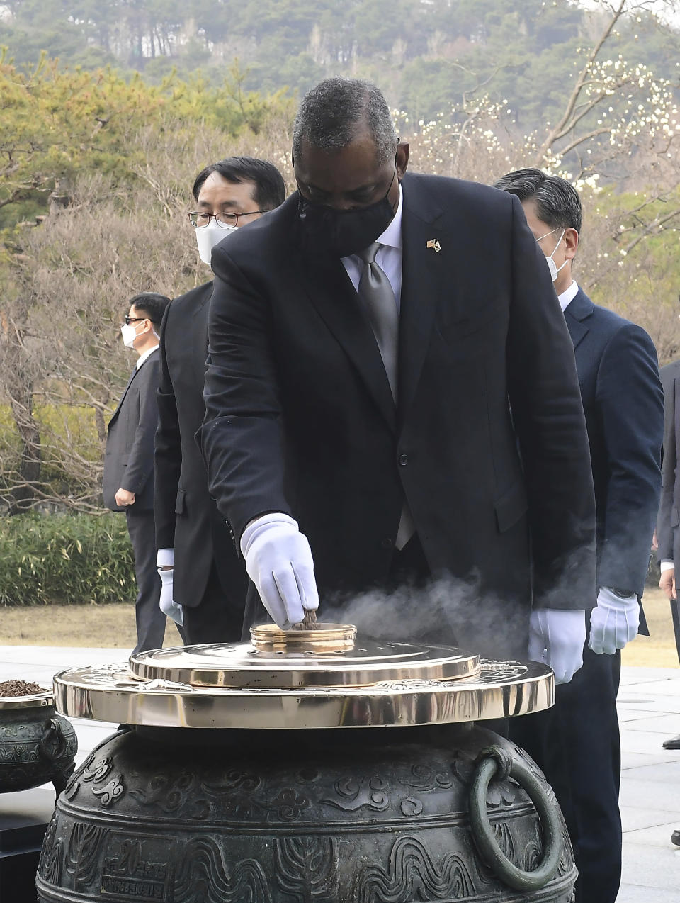 U.S. Defense Secretary Lloyd Austin burns incense to pay tribute to the victims of the Korean War during his visit to the National Cemetery Thursday, March 18, 2021, in Seoul, South Korea. (Kim Min-hee/Pool Photo via AP)
