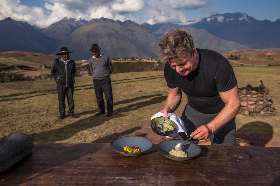 Gordon Ramsay (R) prepares a feast for locals in Peru's Sacred Valley on Gordon Ramsay Uncharted (National Geographic/Ernesto Benavides)