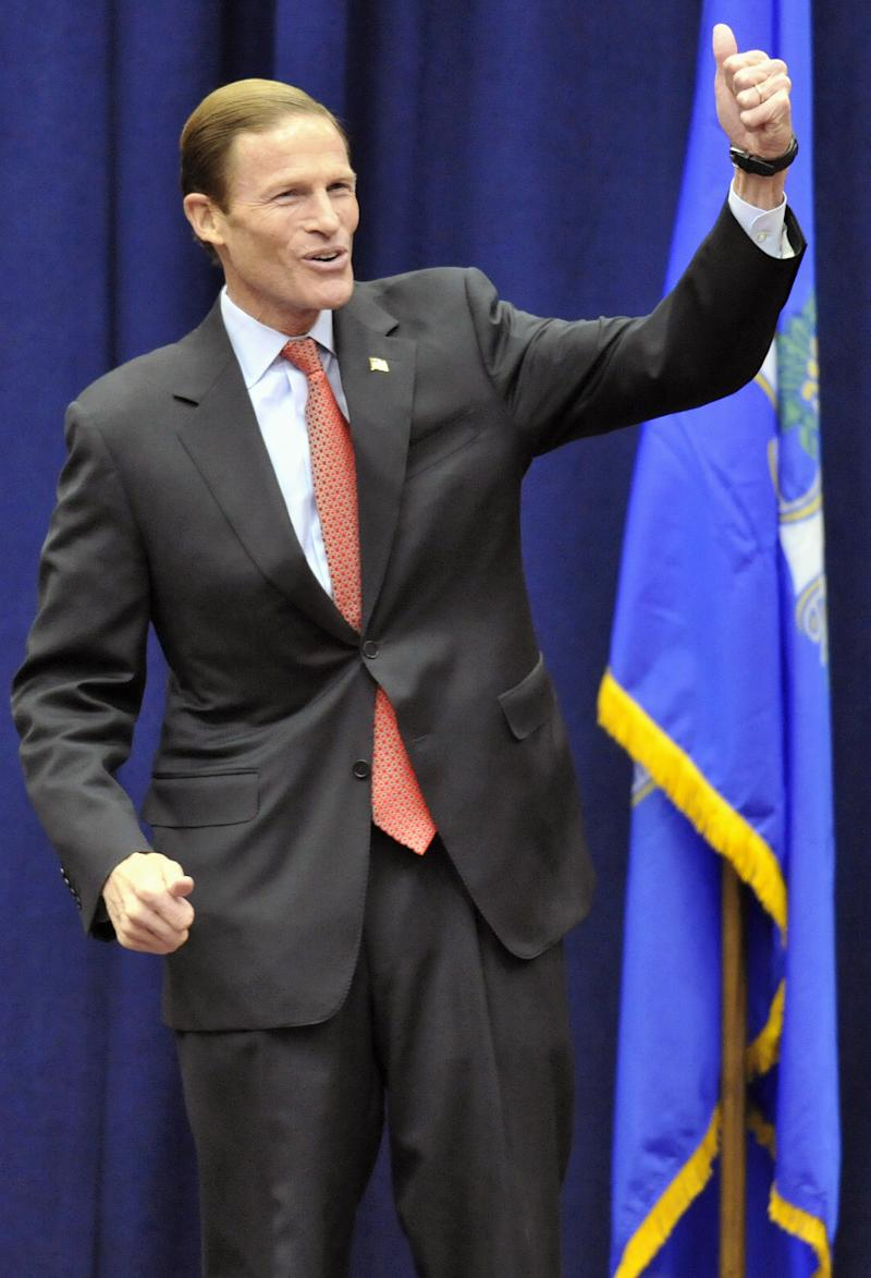 Democratic candidate for U.S. Senate Richard Blumenthal gives the thumbs up to an audience during a rally at the University of Hartford in West Hartford, Conn., Saturday, Oct. 31, 2010. The Connecticut Attorney General Blumenthal is battling former World Wrestling Entertainment CEO Linda McMahon for the senate seat being vacated by the retiring Sen. Chris Dodd.  (AP Photo/Jessica Hill)