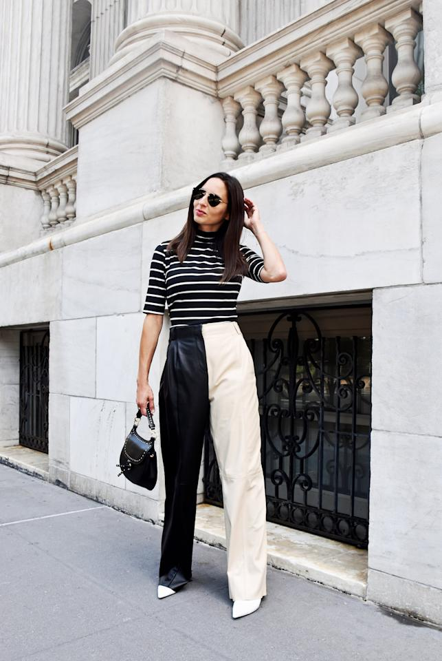 <p>For a simpler take on this outfit, try a pair of solid black leather pants that you can re-wear with all of your Fall tops and knits. </p> <p><em>On Dana: POPSUGAR at Kohl's top, Veda leather pants, Stuart Weitzman boots, a Zara bag, and Illesteva sunglasses.</em></p>