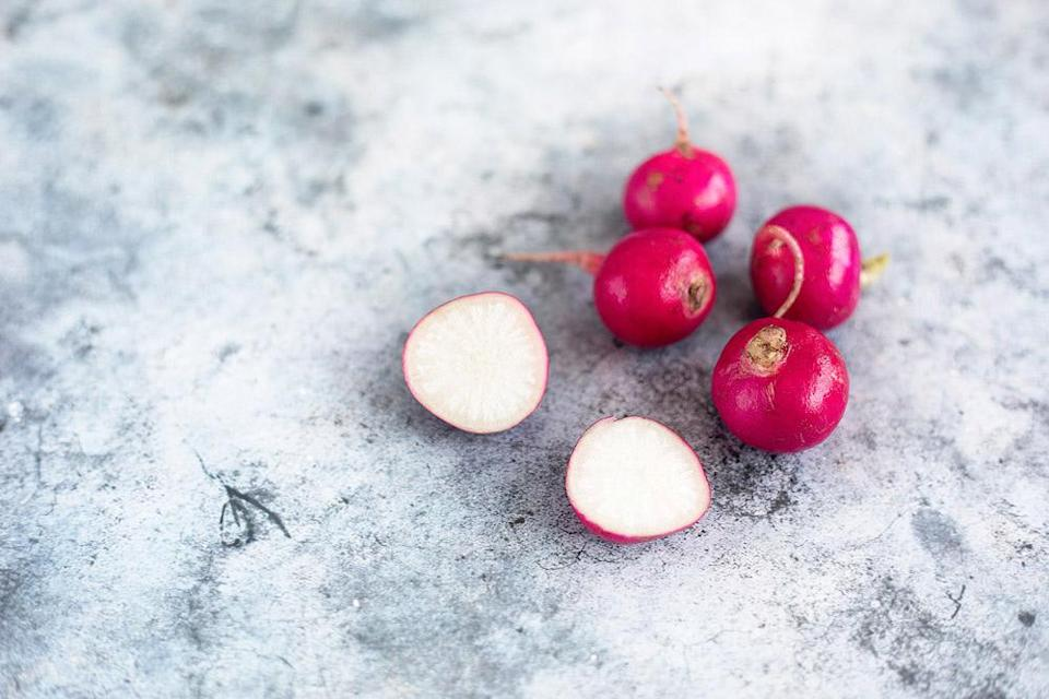 Slice the pink radishes as thinly as you can, perhaps with a mandoline.