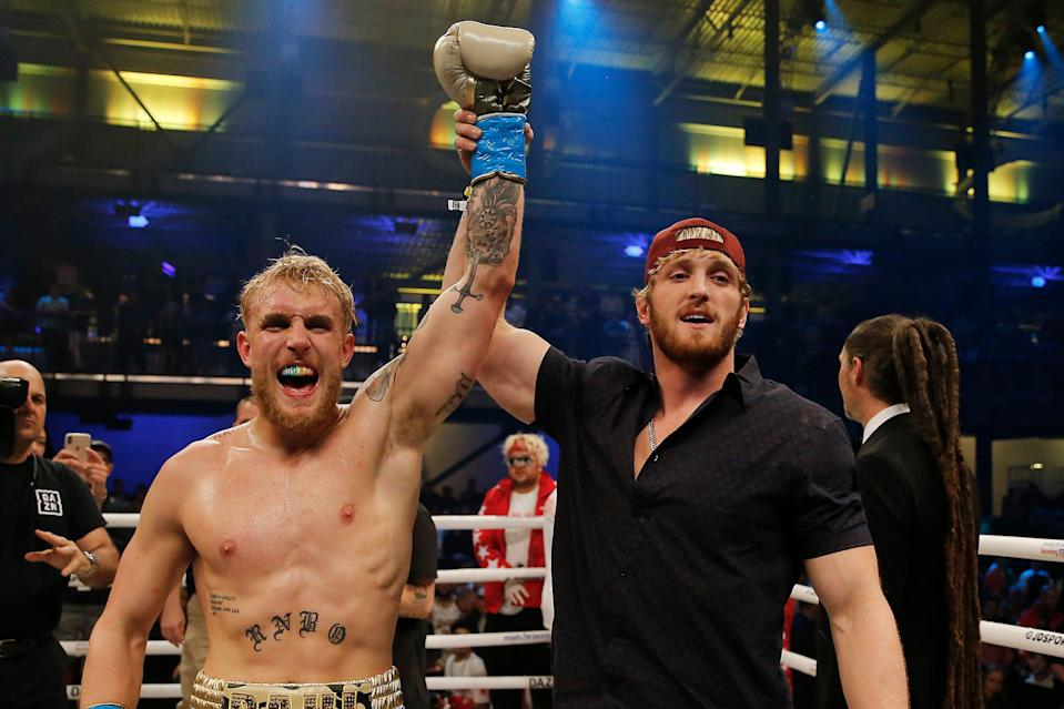 <p>Jake Paul has his hand raised by brother Logan after beating AnEsonGib in January</p> (Getty Images)