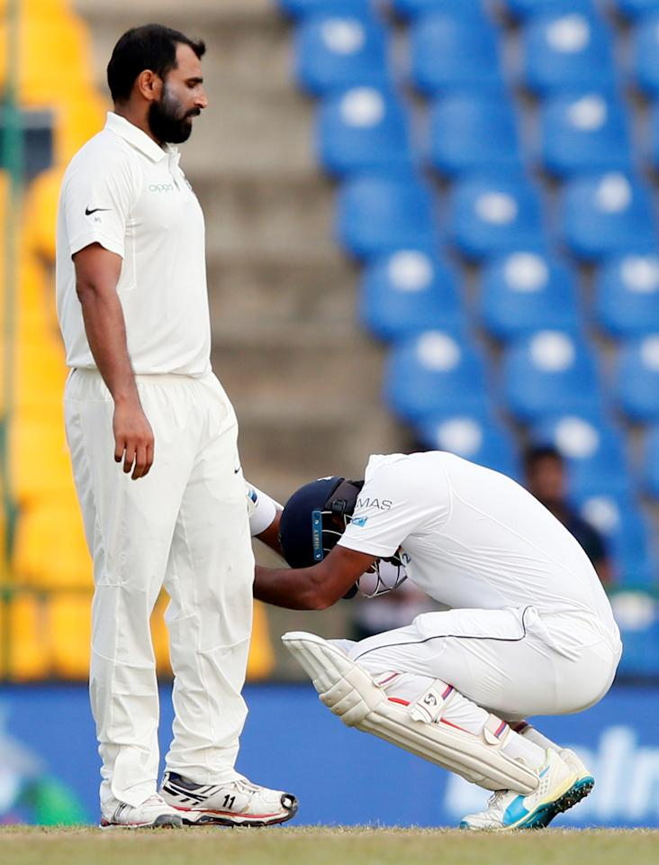 <p>Cricket – Sri Lanka v India – Third Test Match – Pallekele, Sri Lanka – August 13, 2017 – Sri Lanka's Dimuth Karunaratne reacts after a ball hit on his shoulder delivered by India's Mohammed Shami. REUTERS/Dinuka Liyanawatte </p>