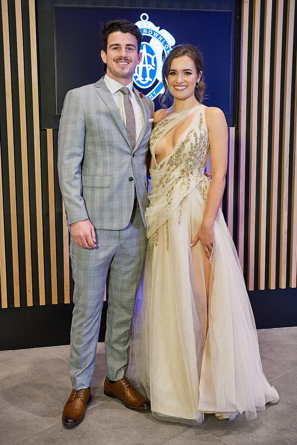 Andrew Brayshaw and partner Lizzie Stock pose for a photo during the 2020 Brownlow Medal Count at Optus Stadium on October 18, 2020 in Perth, Australia.